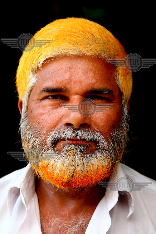 Abdul Mojid.<br /> <br /> It is very common in Bangladesh to see older people with dyed orange hair, men with orange beards or orange moustaches and women with orange hair. The dye used is from the flowering Henna plant. The practice comes from the widely held belief that the Prophet Muhammad dyed his beard and hair. It is also common among people returning from Hajj. Some Muslims believe that henna is the only dye they are free to use for colouring their hair.
