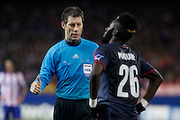 Referee Wolfgang Stark talks to Olympiacos´s Masuaku during Champions League soccer match between Atletico de Madrid and Olympiacos at Vicente Calderon stadium in Madrid, Spain. November 26, 2014. (ALTERPHOTOS/Victor Blanco) /NortePhoto