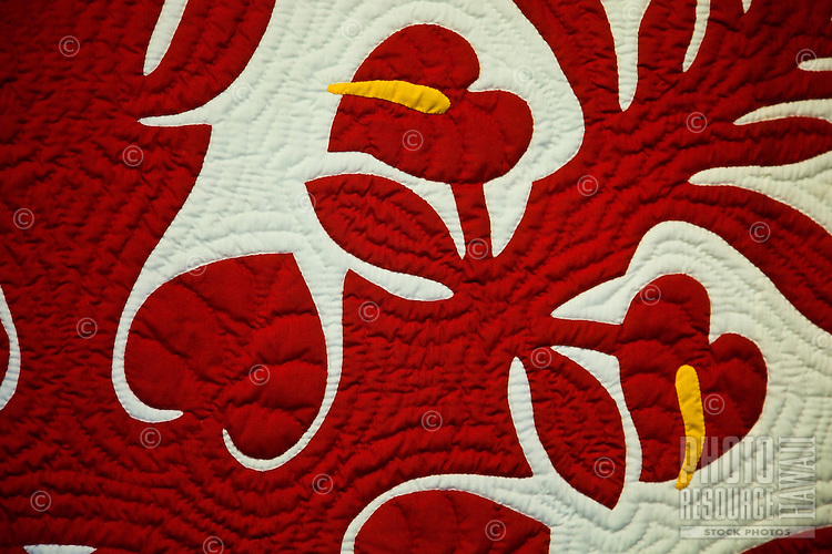 Close up of a red Hawaiian quilt