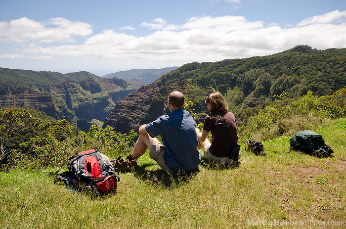 A couple picnicking on the edge of Waimea Canyon, Kauai, Hawaii