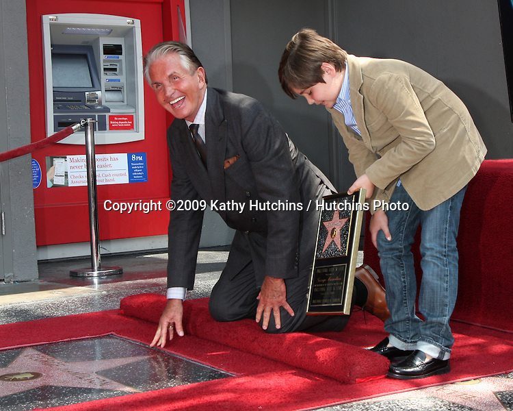 George Hamilton & son GT, with girlfriend at the Hollywood Walk of Fame ceremony bestowing a Star in his honor  in Hollywood, CA  on August 12,  2009 .©2009 Kathy Hutchins / Hutchins Photo.