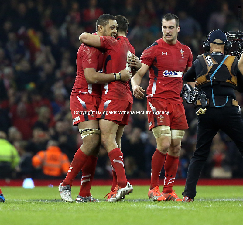 Pictured L-R: Taulupe Faletau of Wales hugs team mate Rhys Webb, watche on by team captain Sam Warburton after the final whistle Saturday 29 November 2014<br />