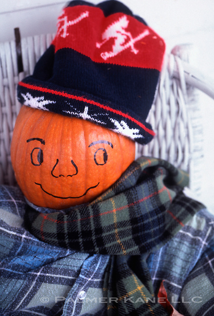Scarecrow decoration made from a pumpkin and old clothing