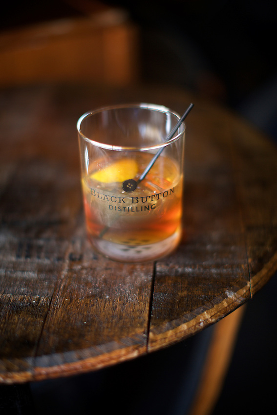 Rochester, NY - June 23, 2016: The tasting room and production facilities at Black Button Distilling, maker of artisanal spirits.<br /> <br /> CREDIT: Clay Williams.<br /> <br /> &copy; Clay Williams / claywilliamsphoto.com