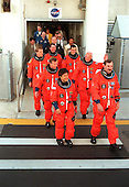 The STS-95 crew leave the Operations and Checkout Building in their flight suits for their trip to Launch Pad 39B on October 29, 1998. Leading the group to the Astrovan for the ride to Launch Pad 39B is Mission Commander Curtis L. Brown Jr. (far right) next to Payload Specialist Chiaki Mukai (left), with the National Space Development Agency of Japan (NASDA). Behind them are (2nd row) Pilot Steven W. Lindsey (left) and Payload Specialist John H. Glenn Jr. (right), senator from Ohio; (3rd row) Mission Specialists Scott E. Parazynski (left) and Pedro Duque of Spain (right), with the European Space Agency; and Mission Specialist Stephen K. Robinson at the rear. Targeted for launch at 2 p.m. EST on Oct. 29, the mission is expected to last 8 days, 21 hours and 49 minutes, and return to KSC at 11:49 a.m. EST on Nov. 7. The STS-95 mission includes research payloads such as the Spartan solar-observing deployable spacecraft, the Hubble Space Telescope Orbital Systems Test Platform, the International Extreme Ultraviolet Hitchhiker, as well as the SPACEHAB single module with experiments on space flight and the aging process.Credit: NASA via CNP