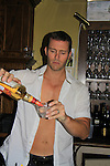 Days Of Our Lives Eric Martsolf bartends at SoapFest's Celebrity Weekend - Celebrity Karaoke Bar Bash - autographs, photos, live auction raising money for kids on November 10, 2012 at Bistro Soleil at Old Historic Marco  Island, Florida. (Photo by Sue Coflin/Max Photos)