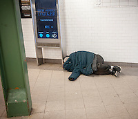 A homeless individual sleeps in a subway station in New York on Saturday, January 28, 2017. (© Richard B. Levine)