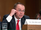 Office of Management and Budget Director Mick Mulvaney, who is also the Acting Director, Consumer Financial Protection Bureau, testifies before the United States Senate Committee on Banking, Housing, and Urban Affairs on the CFPB's Semi-Annual Report to Congress, on Capitol Hill in Washington, DC on Thursday, April 12, 2018.<br /> Credit: Ron Sachs / CNP