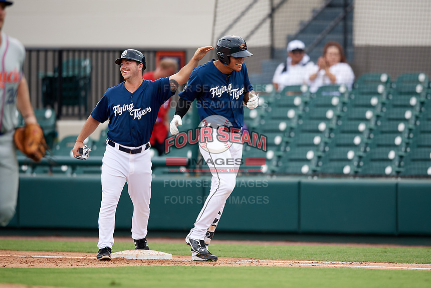 Lakeland Flying Tigers left fielder Elvis Rubio (20) is congratulated after drawing a walk to force in the game winning run during the first game of a doubleheader against the St. Lucie Mets on June 10, 2017 at Joker Marchant Stadium in Lakeland, Florida.  Lakeland defeated St. Lucie 6-5 in fourteen innings.  (Mike Janes/Four Seam Images)