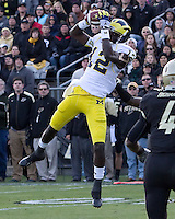 Michigan wide recieiver Devin Gardner (12)makes a 23-yard touchdown catch. The Michigan Wolverines defeated the Purdue Boilermakers 44-13 on October 6, 2012 at Ross-Ade Stadium in West Lafayette, Indiana.