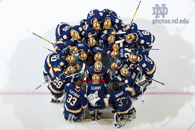 February 17, 2017; The Hockey team huddles before the opening puck drop. (Photo by Matt Cashore/University of Notre Dame)