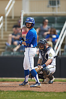 Daniel Vitello (5) of the Mars Hill Lions looks to his third base coach for the sign during the game against the Queens Royals at Intimidators Stadium on March 30, 2019 in Kannapolis, North Carolina. The Royals defeated the Bulldogs 11-6 in game one of a double-header. (Brian Westerholt/Four Seam Images)
