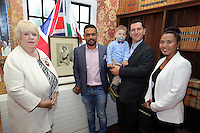 L-R A Council dignitary with recipients of Citizenship Abdullah Al Mamun, young Ibrahim Husejni, Raman Husejni, Marlina Coschignano at the Citizenship Ceremony at Carmarthen Register Office, Carmarthenshire, Wales, UK. Monday 22 August 2016