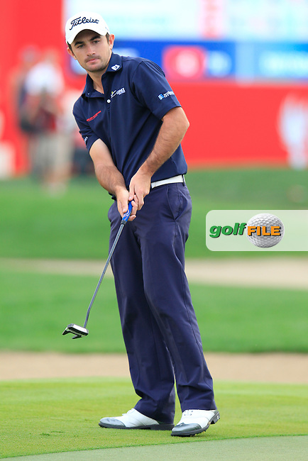 Gary Stal (FRA) takes his putt on the 18th green during Sunday's Final Round of the Abu Dhabi HSBC Golf Championship 2015 held at the Abu Dhabi Golf Course, United Arab Emirates. 18th January 2015.<br /> Picture: Eoin Clarke www.golffile.ie