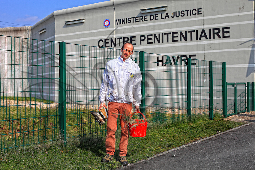 France. Penitentiary of Le Havre. Philippe Cordier posing in front of the penitentiary with his beekeeping material.///France. Centre Pénitancier du Havre. Philippe Cordier pose devant le centre pénitencier avec son matériel apicole.