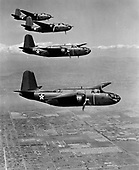 "When the United States entered World War 2,  the A-20 attack bomber had already been proven in combat by British and French forces. On July 4, 1942, six A-20s flown by American crews of the 15th Bombardment Squadron accompanied six flown by British crews on a low-altitude mission against four Dutch airfields, the first United States daylight bombing raid in Europe.  The versatile A-20 was used in the Pacific, Middle East, North African, Russian, and European theaters. Some A-20s equipped with radar equipment and additional nose guns were redesignated as P-70s and were used as night fighters until replaced in 1944 by the P-61 ""Black Widow"" with its increased high altitude performance.  A-20 production halted in September 1944 with more than 7,000 built for the U.S. and its allies. .Credit: U.S. Air Force via CNP"