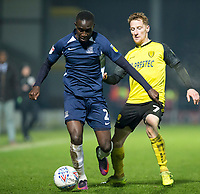 3rd December 2019; Pirelli Stadium, Burton Upon Trent, Staffordshire, England; English League One Football, Burton Albion versus Southend United; Elvis Bwomono of Southend United holds off Stephen Quinn of Burton Albion  - Strictly Editorial Use Only. No use with unauthorized audio, video, data, fixture lists, club/league logos or 'live' services. Online in-match use limited to 120 images, no video emulation. No use in betting, games or single club/league/player publications