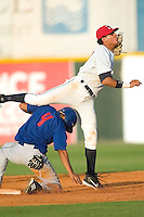 Burlington Indians shortstop Jansy Infante completes a double play while avoiding the slide of Pulaski Blue Jays shortstop Raul Barron at Burlington Athletic Park in Burlington, NC, Saturday, July 29, 2006.  The Indians defeated the Blue Jays by the score of 8-4.