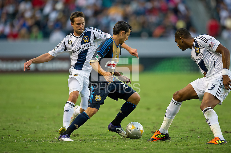 CARSON, CA - July 4, 2012: LA Galaxy defenders Todd Dunivant (2) and David Junior Lopes (3) and Philadelphia Union midfielder Michael Farfan (21) during the LA Galaxy vs Philadelphia Union match at the Home Depot Center in Carson, California. Final score LA Galaxy 1, Philadelphia Union 2.