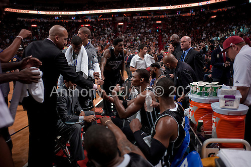 Miami, Florida<br /> January 29, 2012<br /> <br /> The Miami HEAT huddle during a break in the final quarter of the game against the Chicago BULLs. LeBron James sits on the far end as the team coach Erik Spoelstra addresses the players in the American Airlines Arena.