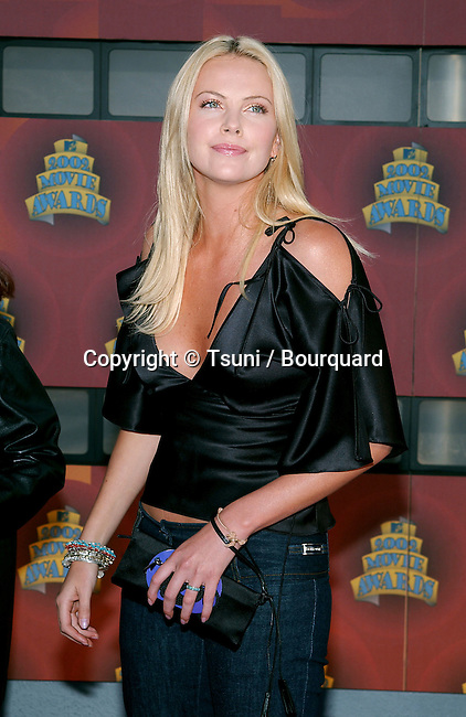Charlize Theron arrives at the 2002 MTV movie Awards at the Shrine Auditorium in Los Angeles. June 1, 2002.           -            TheronCharlize03AA.jpg