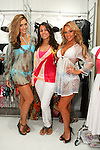 Designer Kariza Luiza (center) poses with models during the CURVENY Designer Lingerie & Swim show, at the Jacob Javits Convention Center, August 3, 2010.