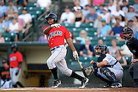 Indianapolis Indians third baseman Yamaico Navarro #26 at bat in front of catcher Francisco Cervelli and umpire Jeff Gosney during a game against the Empire State Yankees at Frontier Field on August 4, 2012 in Rochester, New York.  Empire State defeated Indianapolis 9-8 in ten innings.  (Mike Janes/Four Seam Images)