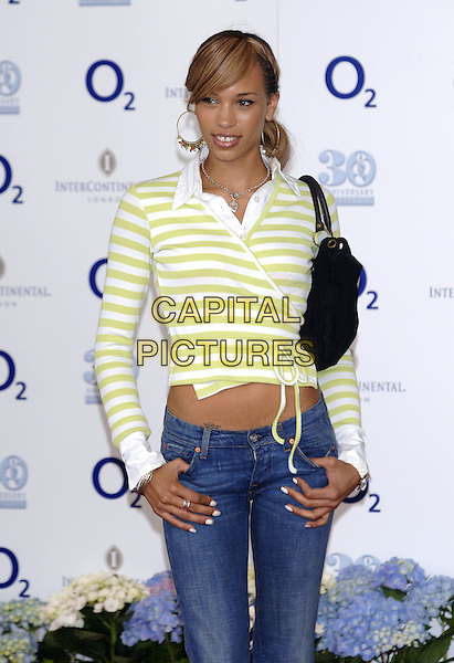 JAVINE HYLTON.Nordoff-Robins Silver Clef Awards 2005,.Intercontinental Hotel, Park Lane, London,.17 June 2005..half length Hilton green white striped wrap around top jeans .Ref: PL.www.capitalpictures.com.sales@capitalpictures.com.©Phil Loftus/Capital Pictures