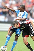 D.C. United forward Chris Pontius (13) goes against Philadelphia Union midfielder Michael Lahoud (13) D.C. United tied The Philadelphia Union 1-1 at RFK Stadium, Saturday August 19, 2012.