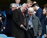Sir Alex Ferguson helps his guest to his seat during the Barclays Premier League match at The Etihad Stadium. Photo credit should read: Simon Bellis/Sportimage