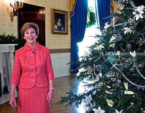 Washington, D.C. - November 30, 2005 -- First lady Laura Bush shows off the White House Christmas decorations to members of the press at the White House in Washington, D.C. on November 30, 2005..Credit: Ron Sachs - Pool