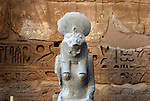 "Granite statue of the lion headed godess Sekhmet at the mortuary temple of Ramses III at Medinet Habu at Thebes.Thebes was the ancient capital of Egypt and was built in and around modern day Luxor.The ancient name for Medinet Habu was Djamet meaning ""males and mothers."" Its holy ground was believed to be where the Ogdoad,the four pairs of primeval gods,were buried.Medinet Habu was both a temple and a complex of temples.Queen Hatshepsut who ruled Egypt from 1479-1458 BC  and Tuthmosis III who reigned from 1479-1425 BC built a small temple to Amun on the site of an earlier structure. Next to their temple, Ramses III who reigned from 1186-1155 BC built his mortuary temple.He then enclosed both structures within a massive mud-brick enclosure.The temple precinct measures about 700 feet by 1000 feet and contains more than 75,350 sq ft of decorated surfaces across its walls.It is the best preserved of all the mortuary temples of Thebes."