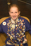 Alaska, Sitka..Girl with Russian friendship pins..Photo copyright Lee Foster, 510/549-2202, lee@fostertravel.com, www.fostertravel.com..