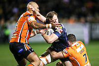 Picture by Alex Whitehead/SWpix.com - 06/03/2015 - Rugby League - First Utility Super League - Castleford Tigers v Wigan Warriors - the Mend A Hose Jungle, Castleford, England - Wigan's Dan Sarginson is tackled by Castleford's Jake Webster and Luke Gale.