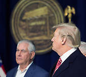 United States Secretary of State Rex Tillerson, left, listens as Republicans take turns speaking to the media at Camp David, the presidential retreat near Thurmont, Maryland, after US President Donald J. Trump, right, held meetings for Cabinet members and Republican members of Congress to discuss the Republican legislative agenda for 2018 on January 6, 2018.<br /> Credit: Chris Kleponis / Pool via CNP