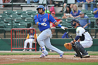 South Bend Cubs shortstop Isaac Paredes (16) swings during a game against the Burlington Bees at Community Field on May 10, 2017 in Burlington, Iowa.  The Bees won 4-3 in 10 innings.  (Dennis Hubbard/Four Seam Images)