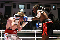 Jumanne Camero (black/red shorts) defeats Liam Richards during a Boxing Show at York Hall on 10th June 2017
