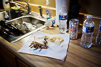 Left-overs from dinner serve as a quick lunch between hunting trips at the Crazy Woman Lodge in Superior, Nebraska, Friday, December 2, 2011. Hunting White Tail deer and wild turkey..Photo by Matt Nager
