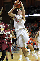 Virginia guard Joe Harris (12) shoots next to Florida State forward Okaro White (10) during the second half of an NCAA basketball game Saturday Jan. 18, 2014 in Charlottesville, VA. Virginia defeated Florida State 78-66. (AP Photo/Andrew Shurtleff)