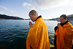 Buddhist priests offer  prayer at the quayside following  a remembrance service to mark the one year anniversary of last year's magnitude 9 earthquake and tsunamis in Ofunato City, Iwate Prefecture, Japan on 11 Mar. 2012. .Photographer: Robert Gilhooly