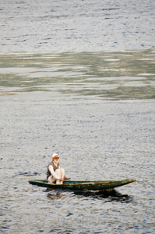 Traditional Kashmiri shikara, or gondola, Dal Lake, Srinagar, Kashmir, india.