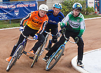 13 SEP 2014 - IPSWICH, GBR - Dan Winchester (right) from Exeter Aces leads Ricki Johnson (left) from Wednesfield Aces and Gary Brown (centre) from Kesgrave Panthers round a bend during a first semi final heat at the  2014 British Open Club Cycle Speedway Championships at Whitton Sports & Community Centre in Ipswich, Great Britain (PHOTO COPYRIGHT © 2014 NIGEL FARROW, ALL RIGHTS RESERVED)