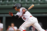 Center fielder Lorenzo Cedrola (5) of the Greenville Drive bats in game one of a doubleheader against the Rome Braves on Tuesday, May 30, 2017, at Fluor Field at the West End in Greenville, South Carolina. Rome won, 10-7. (Tom Priddy/Four Seam Images)