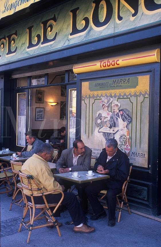 Men having coffee at sidewalk cafe. Isle Sur la Sorgue.  (Provence) France