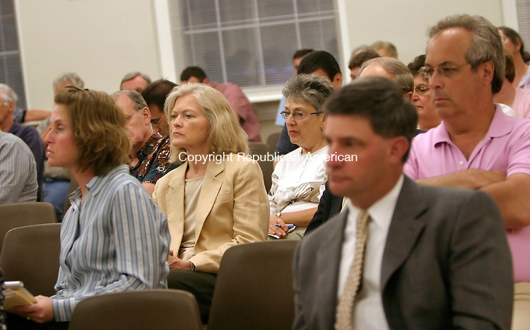MIDDLEBURY, CT, 06 July 2006- 070606BZ04- The audience listens intently during the Middlebury Planning and Zoning Commission meeting regarding Straw Pond at the Shepardson Community Center in Middlebury Thursday night.<br /> Jamison C. Bazinet Republican-American