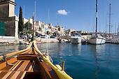 Small maltese gondola called dghajsa in Birgu's (Vittoriosa) Grand Harbour Marina