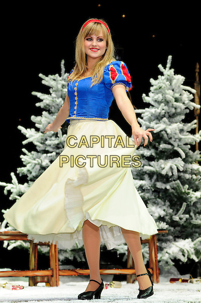 TINA O'BRIEN.First Family Entertainment theatre company's annual group Pantomime photocall at Piccadilly Theatre, London, England..November 26th, 2010.stage costume panto pantomime full length blue dress yellow snow white white spinning twirling .CAP/CAS.©Bob Cass/Capital Pictures.