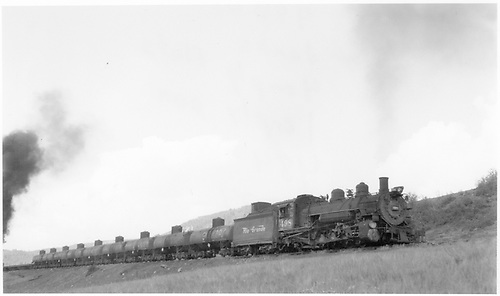 D&amp;RGW #498 with freight train, including 9 tanks, 4 empty flats and a gondola.  #484 is the pusher and is accompanied by caboose #0574.<br /> D&amp;RGW  Cumbres Pass area, CO  Taken by Bender, Henry E. Jr.