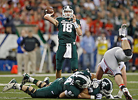 Michigan State Spartans quarterback Connor Cook (18) drops back to pass against Ohio State Buckeyes in the 1st quarter during the Big 10 Championship game at Lucas Oil Stadium in Indianapolis, Ind on December 7, 2013.  (Dispatch photo by Kyle Robertson)