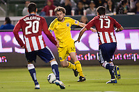 Columbus Crew midfielder Eddie Gavin (12) attempts to dribble through Chivas USA players Zarek Valentin (20) and Ante Jazic (13). Chivas USA and Columbus Crew played to a 0-0 tie at Home Depot Center stadium in Carson, California on  April  9, 2011....